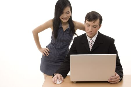 A man shows his female partner something on a laptop computer Stock Photo - 243480
