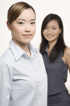 Two pretty asian businesswoman - one in focus and one out of focus Stock Photo - 243709