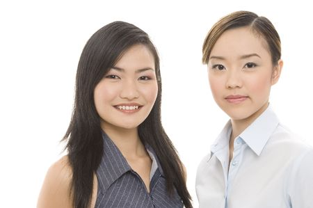 both: Two attractive asian businesswomen - both in focus Stock Photo