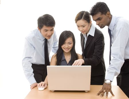A diverse group of business people work on a laptop Stock Photo - 247108