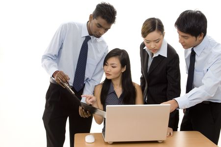 A diverse business team of four individuals work around a laptop computer Stock Photo - 247107