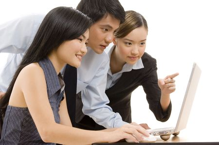 An asian business team looking at a laptop computer Stock Photo - 247114
