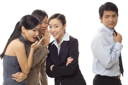 rumours: Three attractive young female workers gossip about one of the male staff