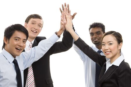 succes: A diverse business team celebrate their succes with a high five