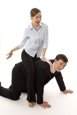 horseplay: A naughty female office worker sits astride a male colleague who looks to be enjoying it! Stock Photo