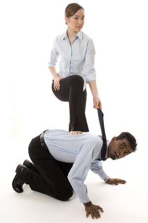 indian male: A cute asian businesswoman dominates an indian male colleague