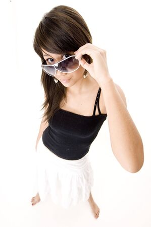 A wide angle shot of a cool teen in sunglasses photo