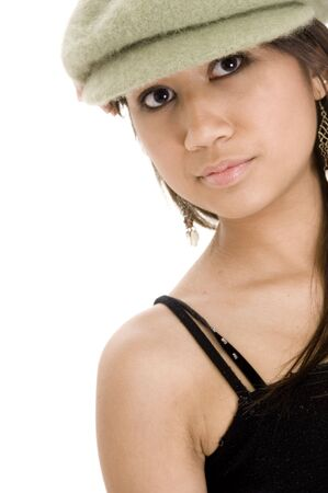 A cool young teenager wears a green hat photo