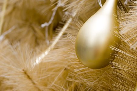 A pear-shaped gold bauble on a gold Christmas tree Stock Photo - 273641