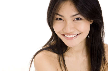 demure: A beautiful young asian woman on white