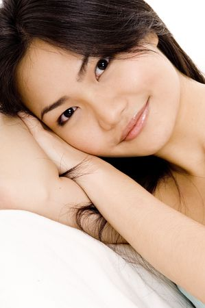 demure: A beautiful young asian woman resting and smiling Stock Photo
