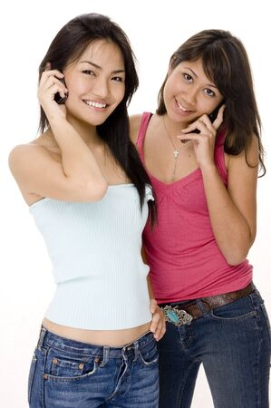 demure: Two pretty young women on the phone Stock Photo