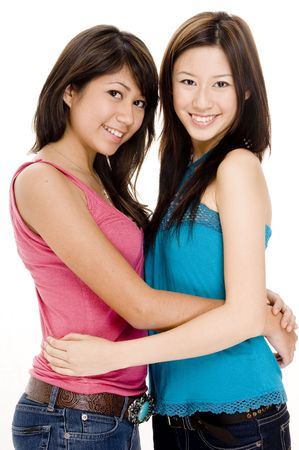 top  model: Two pretty young women holding each other