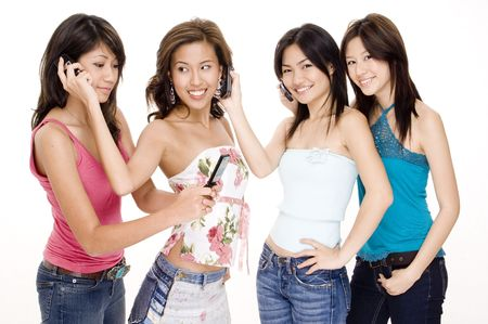 swap: Four beautiful young asian women using cellphones Stock Photo