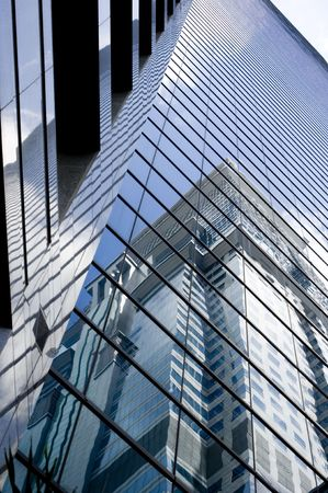 A glass skyscraper towers into the Singapore sky photo