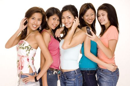 gadget: Five young asian women with phones and mp3 players
