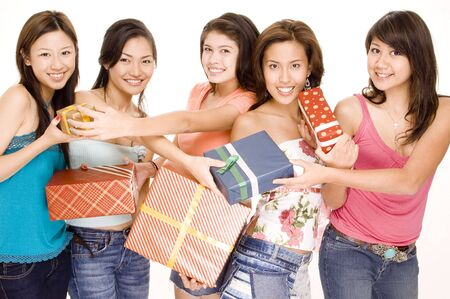 swap: Five pretty asian women swap gifts and presents