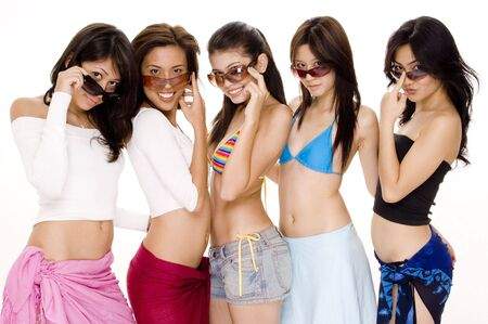 Five attractive asian women in summer clothes on white background photo