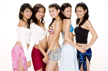 beach wrap: Five attractive young women in summer clothing Stock Photo