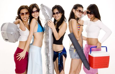 beach mat: Five cute young women are off to the beach Stock Photo