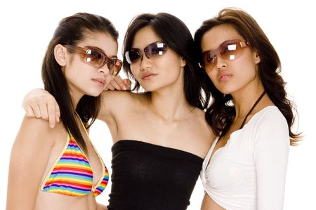 babes: Three attractive asian women in sunglasses Stock Photo
