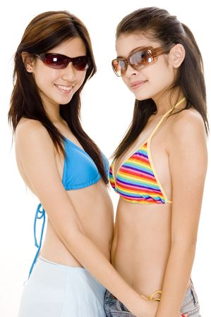 A pair of pretty asian women in summer clothes photo