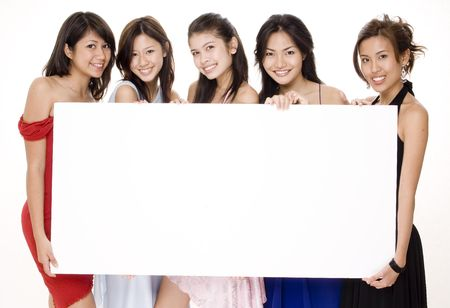 Five attractive asian women holding a big blank sign photo