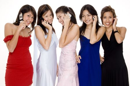 Five pretty women in evening dresses all talking on phones photo