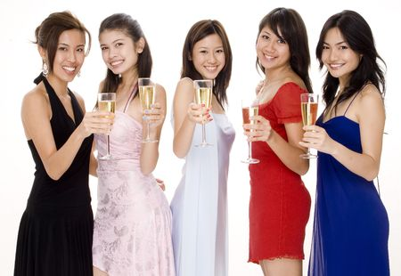 'evening wear': Five attractive young asian women in evening wear toast with champagne