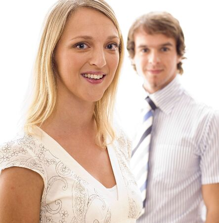 A businesswoman with businessman out of focus behind Stock Photo - 305598