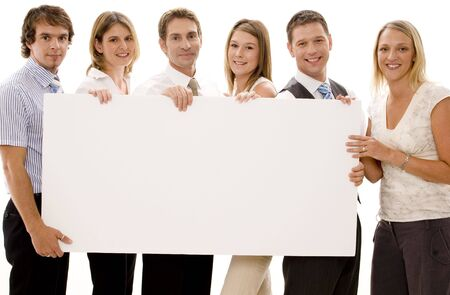 Six business men and women holding a big blank sign Stock Photo - 306414