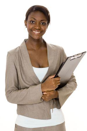 A smiling young black businesswoman on white background Stock Photo