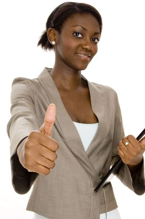 A successful young black businesswoman gives the thumbs up