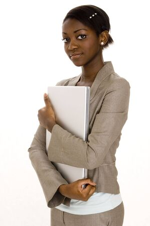 A serious young businesswoman holding a laptop computer on white background Stock Photo - 359087