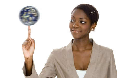 A young woman holds a spinning globe on the end of her finger Stock Photo