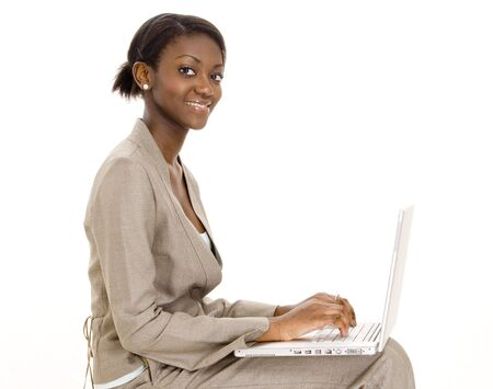 A happy young black woman using a laptop computer