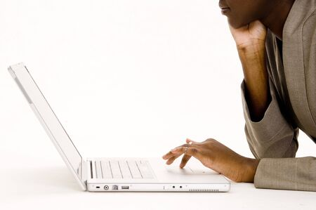 A laptop user lying on the floor on white background