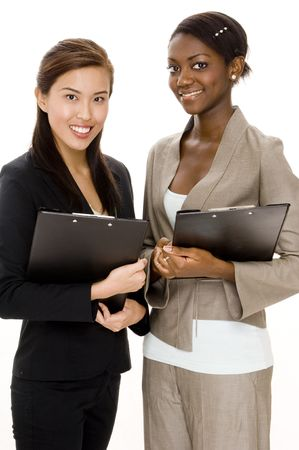 Two attractive young business women with clipboards Stock Photo