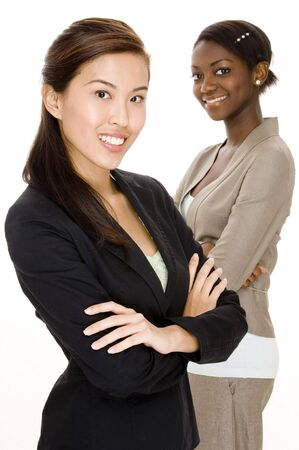 An asian business woman standing in front of her colleague