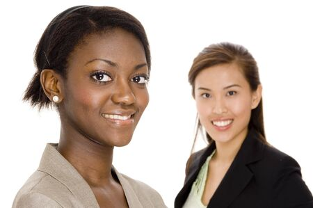 An attractive young black woman standing in front of her asian colleague