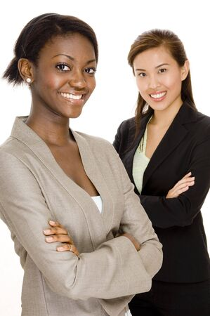 Two smiling attractive young business women on white background