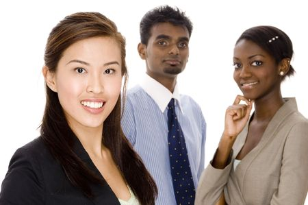 A young asian businesswoman standing in front of her two colleagues Stock Photo