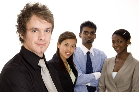 A fashionable young businessman standing in front of his diverse business team Stock Photo