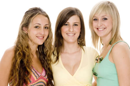 Three attractive young women in colorful casual clothing