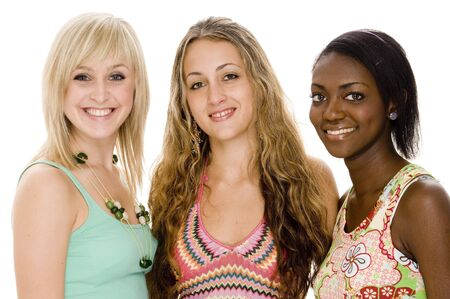 Three beautiful young women in colorful casual clothing Stock Photo