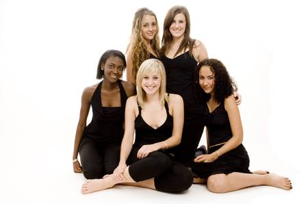 Five beautiful young women in black on white background