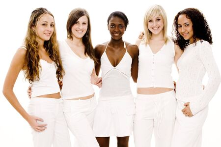 A group of five pretty young women in white on white