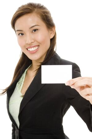 A young asian businesswoman holding a blank business card