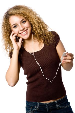 portable mp3 player: A young woman listening to music on a portable mp3 player Stock Photo