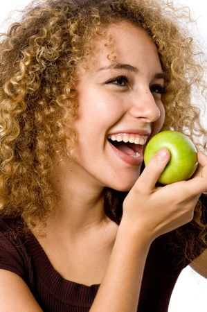 A pretty young woman holding an apple shes about to eat Stock Photo